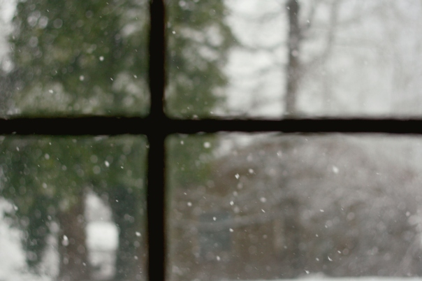 snow through windowpane